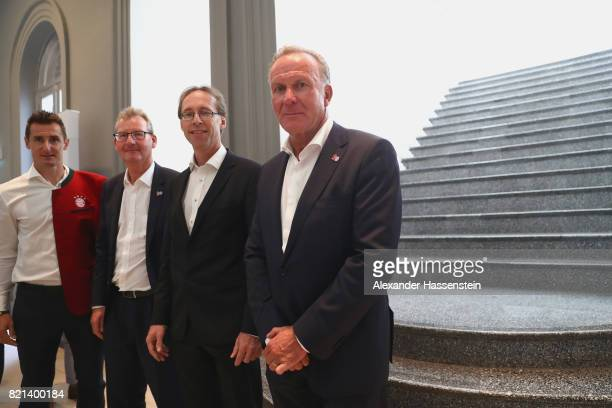 KarlHeinz Rummenigge CEO of Bayern Muenchen visits with Steffen Koch Acting head of Mission German Embassy Singapore Dieter Mayer VicePresident of FC...