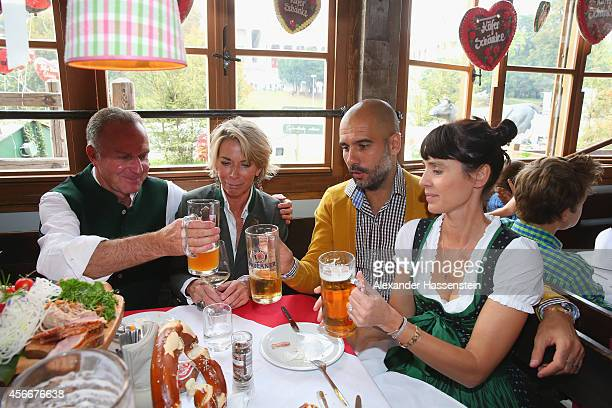 KarlHeinz Rummenigge CEO of FC Bayern Muenchen attends with his wife Martina Rummenigge and head coach Josep Guardiola and his wife Cristina...