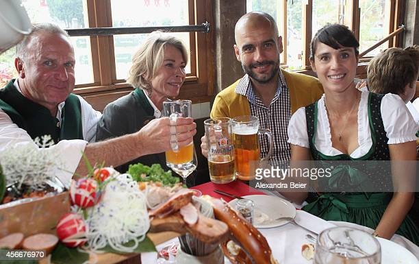 KarlHeinz Rummenigge CEO of FC Bayern Muenchen attends with his wife Martina Rummenigge and team coach Josep Guardiola and his wife Cristina...