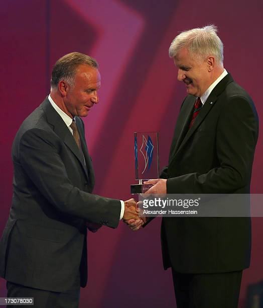 KarlHeinz Rummenigge CEO of FC Bayern Muenchen receives the Bavarian Sportaward 2013 from Bavarian state governor Horst Seehofer during the Bavarian...