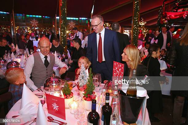 KarlHeinz Rummenigge CEO of FC Bayern Muenchen talks to Arjen Robben during the FC Bayern Muenchen Christmas Party at Alfons Schuhbeck`s...