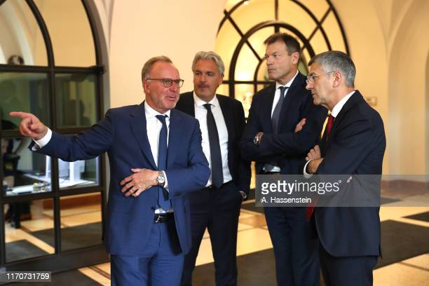 KarlHeinz Rummenigge CEO of FC Bayern Muenchen talks to Board Members Joerg Wacker Andreas Jungand Herbert Hainer during a reception of the...
