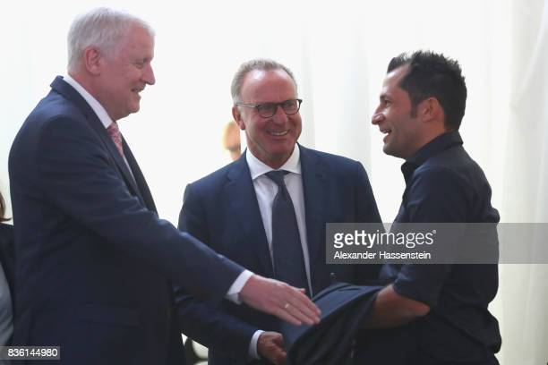 KarlHeinz Rummenigge CEO of FC Bayern Muenchen talks to Horst Seehofer Bavarian Governor and Hasan Salihamidzic Sporting director of FC Bayern...