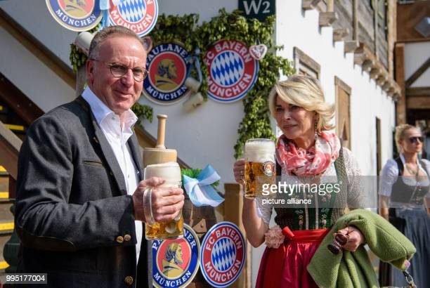 KarlHeinz Rummenigge chairman of FC Bayern Munich arrives at the Kaeferzelt tent with his wife Martina Rummenigge at the Theresienwiese in Munich...