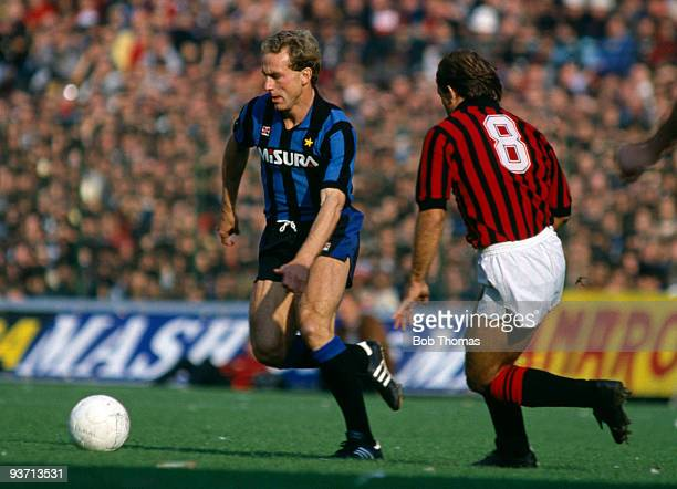 KarlHeinz Rummenigge of Inter Milan and Ray Wilkins of AC Milan during the Inter Milan v AC Milan Italian League match held at San Siro Stadium in...