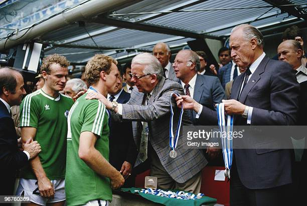 KarlHeinz Rummenigge of West Germany receives his runner up medal after losing the FIFA World Cup final on 29 June 1986 at the Azteca Stadium in...