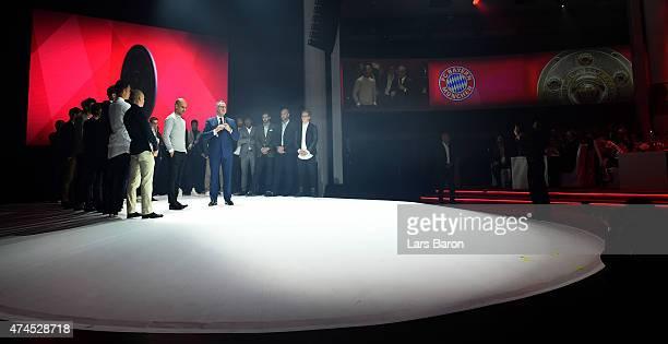 KarlHeinz Rummenigge the executive board chairman of Bayern Muenchen congratulates head coach Josep Guardiola during the FC Bayern Muenchen Champions...