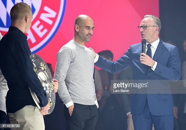 KarlHeinz Rummenigge the executive board chairman of Bayern Muenchen congratulates head coach Josep Guardiola during the FC Bayern Muenchen Champions...