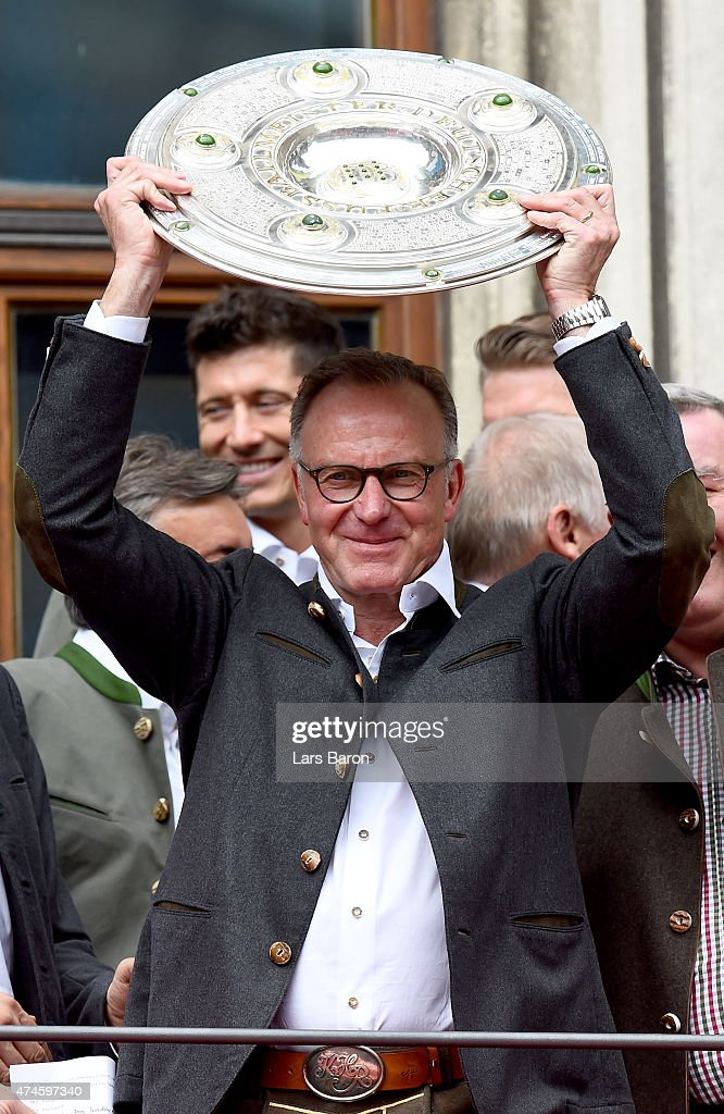 Karl-Heinz Rummenigge the executive board chairman of Bayern Muenchen lifts the trophy and celebrates winning the Bundesliga at Marienplatz on May 24, 2015 in Munich, Germany.