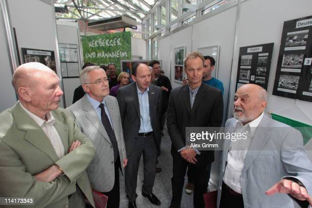 KarlHeinz SchwarzPich leeds Horst Eckel and Horst R Schmidt through the exhibition in honour of former German national coach Sepp Herberger on May 14...