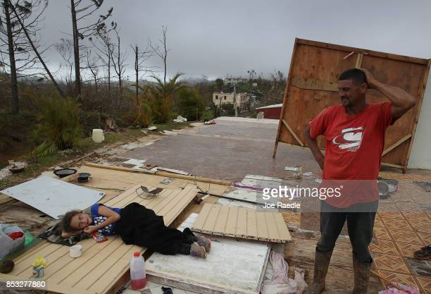 Karlian Mercado and her father Carlos Flores stand on what remains of their home September 24 2017 in Hayales de Coamo Puerto Rico Puerto Rico...