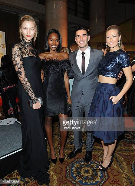 Karlie Kloss Adam Braun Tehillah Voslevitz and Damaris Lewis attend the Pencils Of Promise Gala 2015 at Cipriani Wall Street on October 21 2015 in...