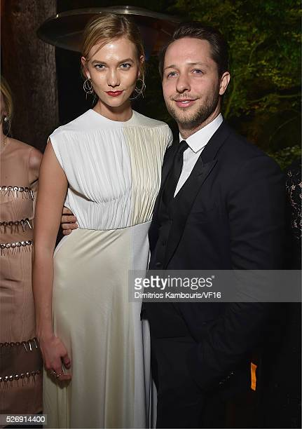 Karlie Kloss and Derek Blasberg attend the Bloomberg Vanity Fair cocktail reception following the 2015 WHCA Dinner at the residence of the French...
