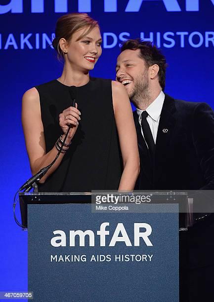 Karlie Kloss and Derek Blasberg speak onstage during the 2014 amfAR New York Gala at Cipriani Wall Street on February 5 2014 in New York City