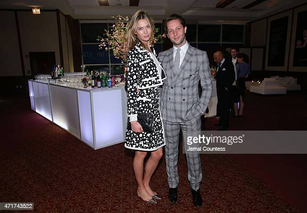 Karlie Kloss and EditoratLarge of Harper's Bazaar Derek Blasberg attend the International Center of Photography 31st annual Infinity Awards at Pier...