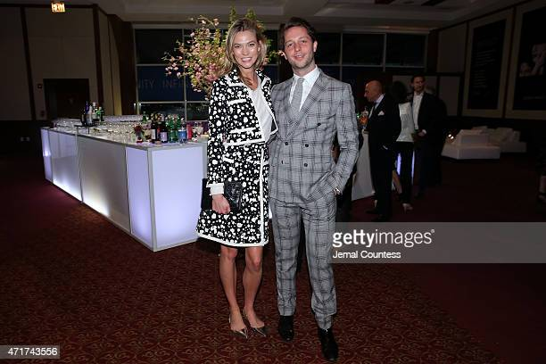 Karlie Kloss and EditoratLarge of Harper's Bazaar Derek Blasberg attend the International Center of Photography 31st annual Infinity Awards at Pier...