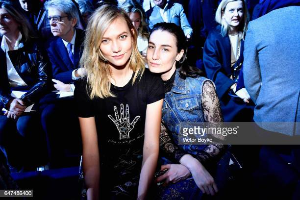 Karlie Kloss and Erin O'Connor attend the Christian Dior show as part of the Paris Fashion Week Womenswear Fall/Winter 2017/2018 on March 3 2017 in...