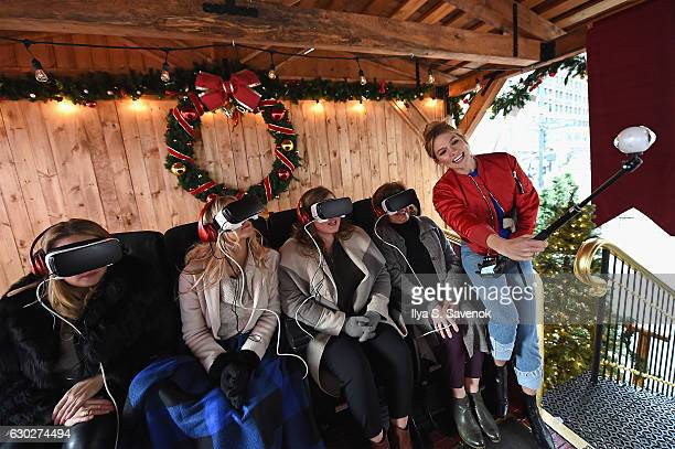 Karlie Kloss and her family stop by the 4D VR Sleigh Ride Experience at Samsung VR Presents The Night Before in Herald Square on December 19 2016 in...