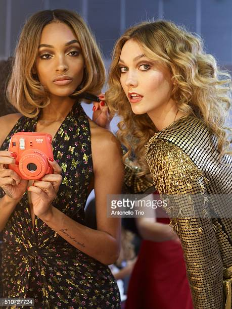 Karlie Kloss and Jourdan Dunn pose wearing Diane Von Furstenberg Fall 2016 during New York Fashion Week on February 14 2016 in New York City