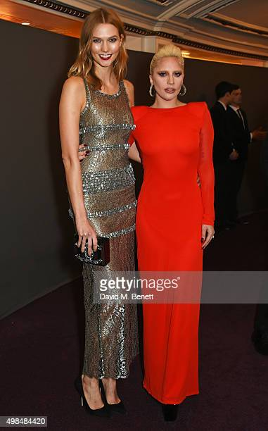 Karlie Kloss and Lady Gaga attend the British Fashion Awards in partnership with Swarovski at the London Coliseum on November 23 2015 in London...