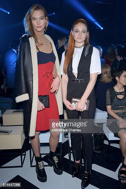 Karlie Kloss and Sophie Turner attend the Louis Vuitton show as part of the Paris Fashion Week Womenswear Fall/Winter 2016/2017 on March 9 2016 in...