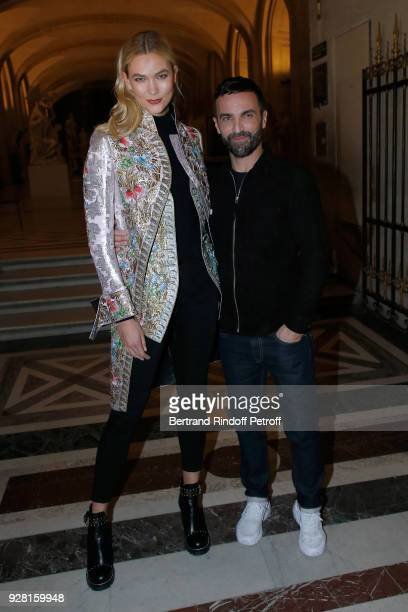 Karlie Kloss and Stylist Nicolas Ghesquiere pose after the Louis Vuitton show as part of the Paris Fashion Week Womenswear Fall/Winter 2018/2019 on...