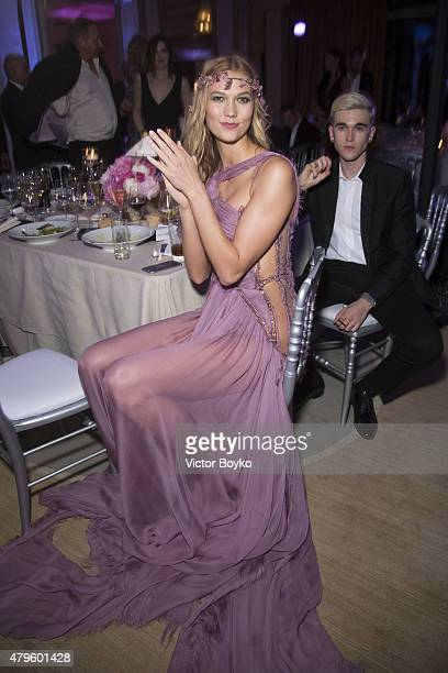 Karlie Kloss attends the amfAR dinner at the Pavillon LeDoyen during the Paris Fashion Week Haute Couture on July 5 2015 in Paris France