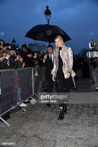 Karlie Kloss attends the Louis Vuitton show as part of the Paris Fashion Week Womenswear Fall/Winter 2018/2019 on March 6 2018 in Paris France