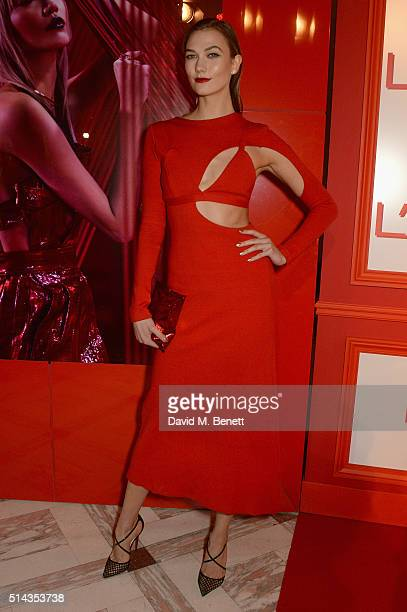 Karlie Kloss attends the Red Obsession party to celebrate L'Oreal Paris's partnership with Paris Fashion Week on March 8 2016 in Paris France L'Oreal...