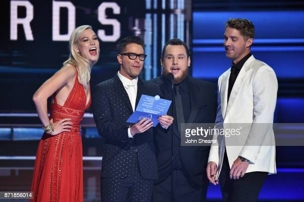 Karlie Kloss Bobby Bones Luke Combs and Brett Young speak onstage at the 51st annual CMA Awards at the Bridgestone Arena on November 8 2017 in...