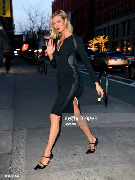 Karlie Kloss heads back into her office in a black bodyhugging dress on March 11 2019 in New York City