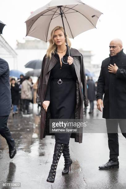 Karlie Kloss is seen on the street attending Balenciaga during Paris Women's Fashion Week A/W 2018 wearing Balenciaga on March 4 2018 in Paris France