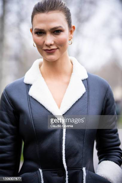 Karlie Kloss is seen outside Loewe fashion show on February 28, 2020 in Paris, France.