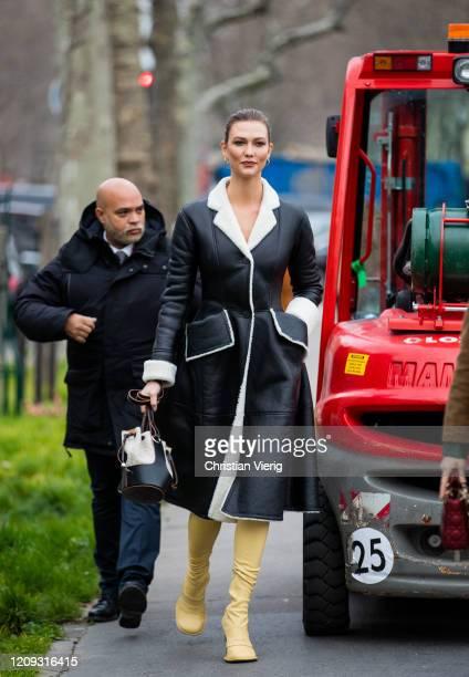 Karlie Kloss is seen wearing black white shearling coat, bag yellow boots outside Loewe during Paris Fashion Week - Womenswear Fall/Winter 2020/2021...