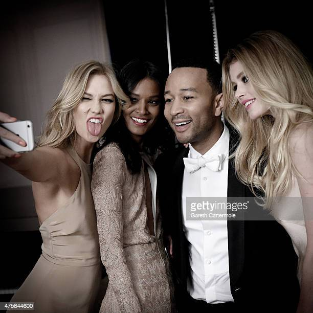 Karlie Kloss Liya Kebede John Legend and Doutzen Kroes pose backstage during filming for L'Oreal during the 68th annual Cannes Film Festival on May...