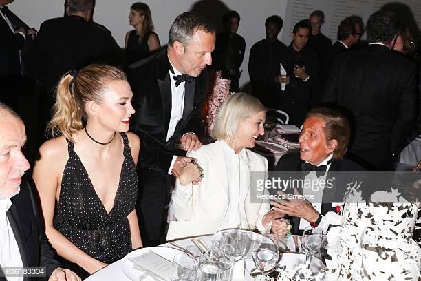 Karlie Kloss Maria Grazia Chiuri and Valentino Garavani attend the Guggenheim International Gala at the Solomon R Guggenheim Museum on November 17...