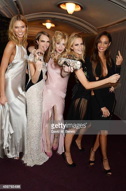 Karlie Kloss Model of the Year winner Cara Delevingne Courtney Love Poppy Delevingne and Joan Smalls attend the British Fashion Awards at the London...