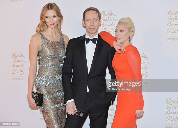 Karlie Kloss Nick Knight and Lady Gaga pose in the Winners Room at the British Fashion Awards 2015 at London Coliseum on November 23 2015 in London...