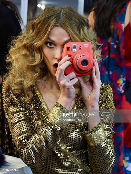 Karlie Kloss pose wearing Diane Von Furstenberg Fall 2016 during New York Fashion Week on February 14 2016 in New York City