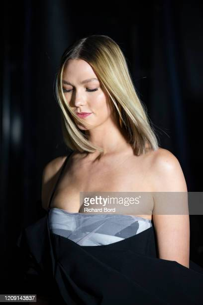 Karlie Kloss prepares backstage before the Off-White Womenswear Fall/Winter 2020/2021 show at AccorHotels Arena as part of Paris Fashion Week on...