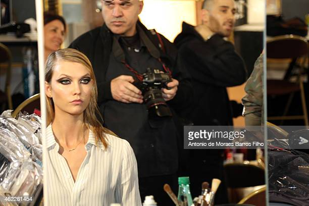 Karlie Kloss prepares backstage prior to Versace show as part of Paris Fashion Week HauteCouture Spring/Summer 2015 on January 25 2015 in Paris France