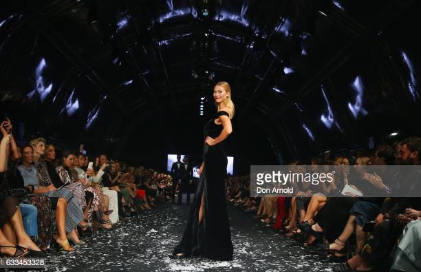 Karlie Kloss showcases designs by Rachel Gilbert on the runway at the David Jones Autumn Winter 2017 Collections Launch at St Mary's Cathedral...