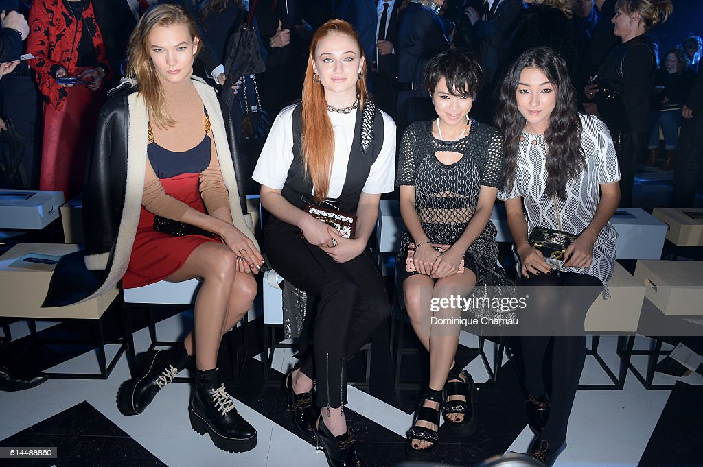 Karlie Kloss, Sophie Turner, a guest and Natasha Liu Bordizzo attend the Louis Vuitton show as part of the Paris Fashion Week Womenswear Fall/Winter 2016/2017 on March 9, 2016 in Paris, France.