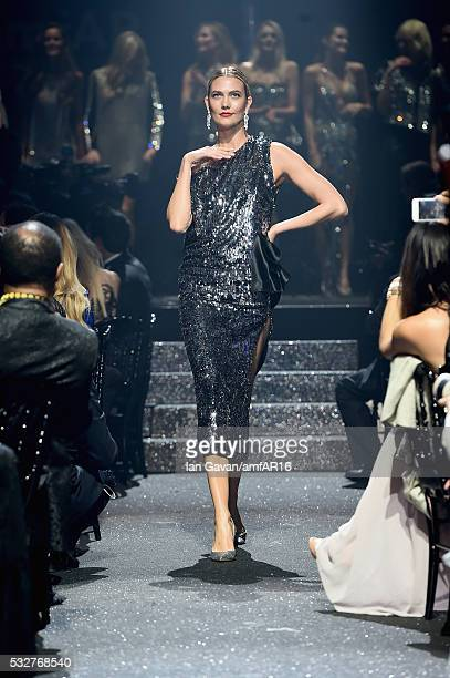 Karlie Kloss walks the runway at the amfAR's 23rd Cinema Against AIDS Gala at Hotel du CapEdenRoc on May 19 2016 in Cap d'Antibes France