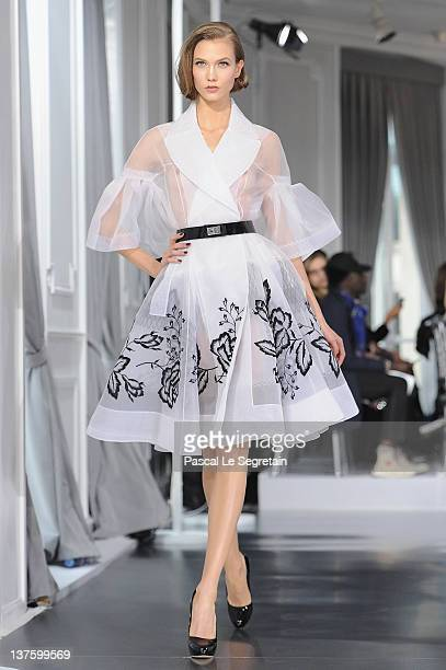 Karlie Kloss walks the runway during the Dior HauteCouture 2012 show as part of Paris Fashion Week at Salons Christian Dior on January 23 2012 in...