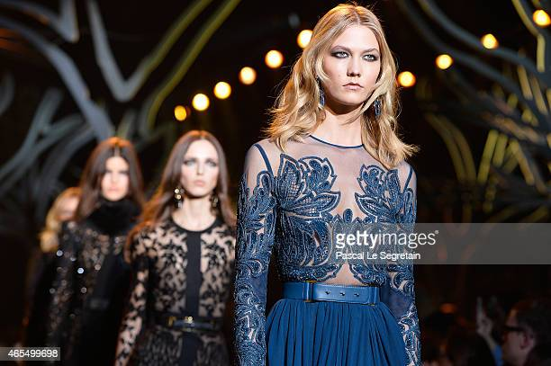 Karlie Kloss walks the runway during the Elie Saab show as part of the Paris Fashion Week Womenswear Fall/Winter 2015/2016 on March 7 2015 in Paris...