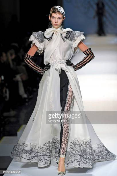 Karlie Kloss walks the runway during the Jean Paul Gaultier Haute Couture Spring/Summer 2009 fashion show as part of the Paris Haute Couture Fashion...