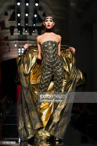 Karlie Kloss walks the runway during the Jean-Paul Gaultier Haute-Couture Show as part of Paris Fashion Week Fall / Winter 2013 on July 4, 2012 in...