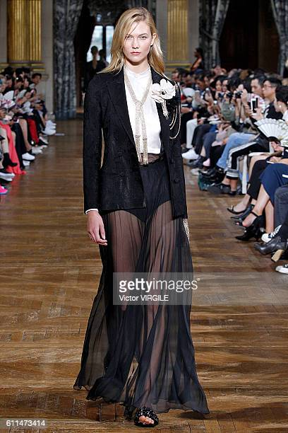 Karlie Kloss walks the runway during the Lanvin Ready to Wear fashion show as part of the Paris Fashion Week Womenswear Spring/Summer 2017 on...