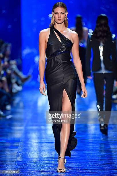 Karlie Kloss walks the runway during the Mugler Ready to Wear designed by David Koma fashion show as part of the Paris Fashion Week Womenswear...